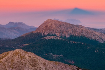 The Tomir mountain under the casting shadow of puig de Massanella, Tramuntana mountains, Majorca