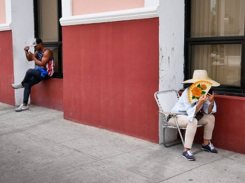 a couple of cubans in the new times, workshops about photography in cuba