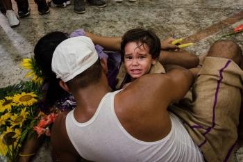 children faith in Saint Lazarus pilgrimage, photography tour in Cuba