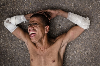 pain and faith to sain lazarus in religion photography tours in cuba
