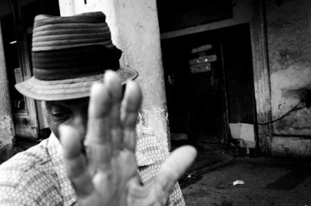 man hidding his face, cuban photography fine art by louis alarcon
