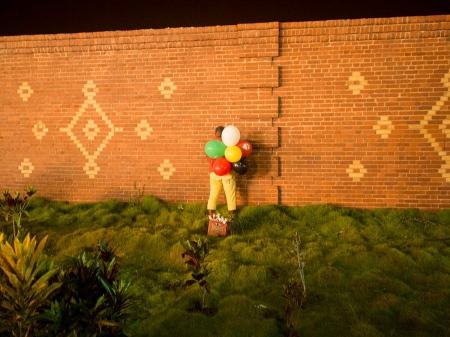 man urinating in a wall in Cuba carnivals, a cuban picture taken in Havana