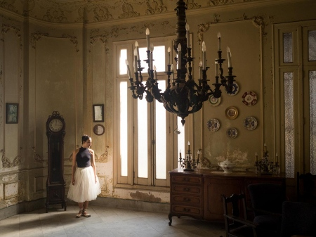 colonial lamp and ballet dancer in havana, cuban photography about old luxury