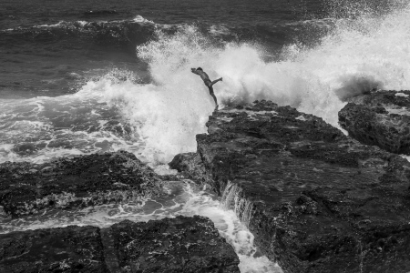 jumping against a wave in Cuba, cuban photography