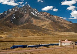 Train, church and Andean Mountains. Abra la Raya 4335 m.o.s.l.
