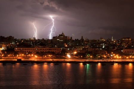 rays and storm in havana city, by louis alarcon