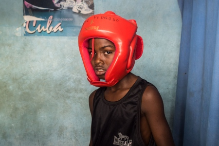 portrait of a cuban young boxer whith red boxer hat