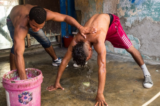 two cuban boxers taking a special shower after the match in Rafael Trejo boxing gym