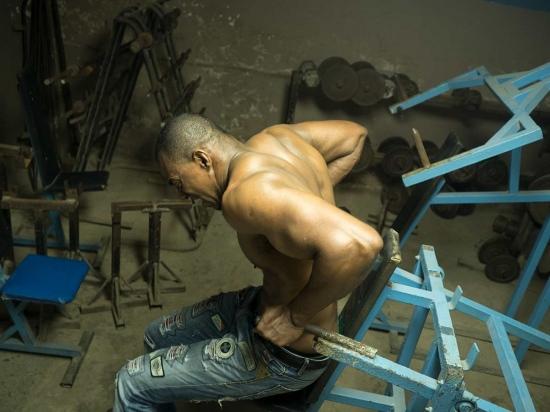 alain training in a vintage gym of havana