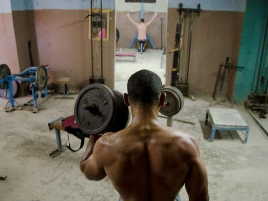 muscles of cuban men in a havana´s gym