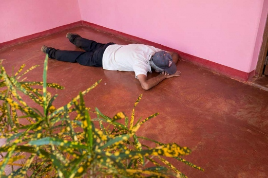 old cuban man resting on the floor
