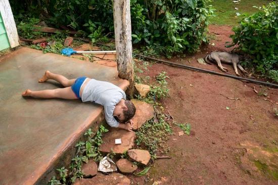 little cuban kid laying on the floor