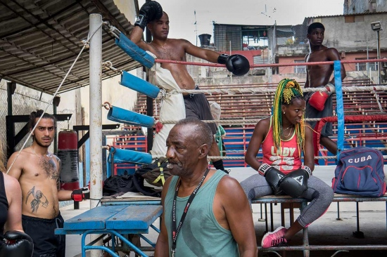 group of boxers resting in Havana old boxing gym