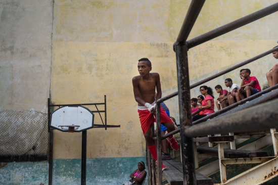 public looking to cuban boxers in a old gym in old havana