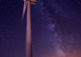Wind turbine and Milky Way. Eolic energy