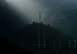 High voltage Towers in the landscape, at backlight. Distribution of electric energy