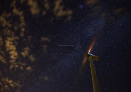 Wind turbines at starry night