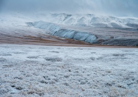 Snowy tundra and Richardson Mountains. Dempster Highway. NWT